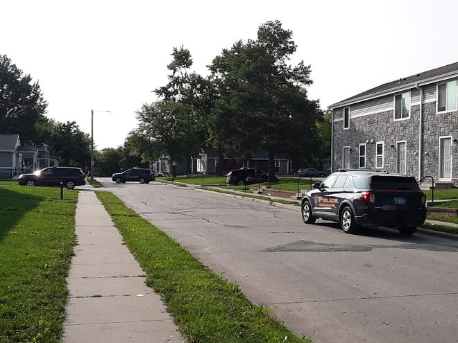 Several police vehicles park along the 2300 block of Washington Street Monday after several shots were fired in the area.