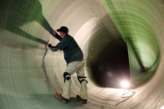 A quality inspector takes measurements of the interior of a blade at the Siemens Wind Turbine Blade Factory south of Fort Madison. On Monday morning, Siemens-Gamesa officials confirmed about 130 employees have been laid off.