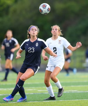 Twinsburg midfielder Breanna Utrup (23), shown here earlier this season against Cuyahoga Falls, scoring the lone goal in the Tigers' 1-0 win over North Royalton Sept. 9.