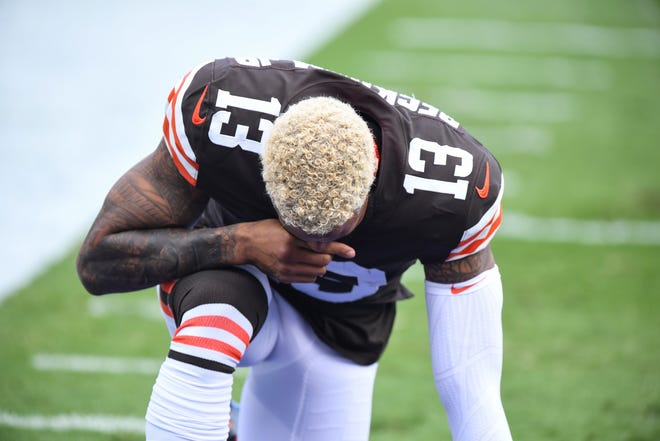 Cleveland Browns wide receiver Odell Beckham Jr. (13) kneels prior to the playing of the National Anthem before an NFL football game against the Baltimore Ravens, Sunday, Sept. 13, 2020, in Baltimore. (AP Photo/Terrance Williams)