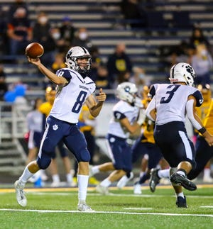 Twinsburg quarterback Trevor Horvath fires a pass during the Tigers' 31-7 loss at Copley Sept. 11.