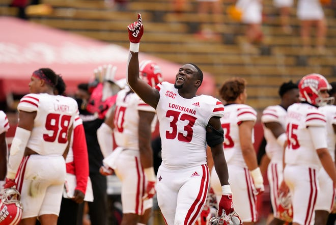 Louisiana-Lafayette linebacker Tyler Guidry celebrates on the sideline during the second half of an NCAA game against Iowa State on Saturday in Ames, Iowa. Louisiana-Lafayette won 31-14.