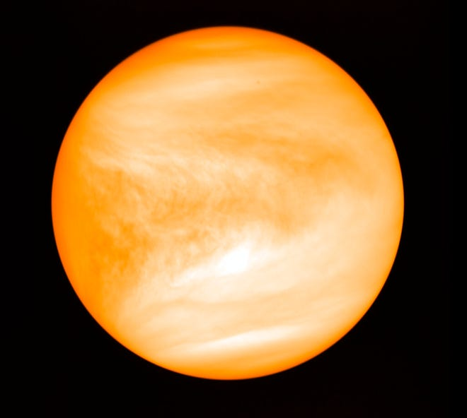 This May 2016 photo provided by researcher Jane Greaves shows the planet Venus, seen from the Japan Aerospace Exploration Agency's Akatsuki probe. A report released on Monday says astronomers have found a potential signal of life high in the atmosphere of our nearest neighboring planet.
