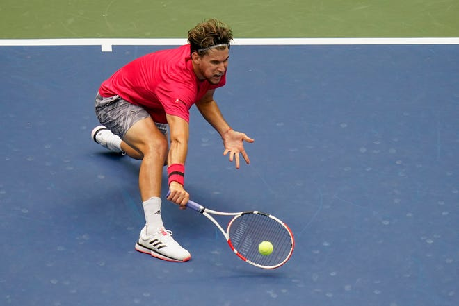 Dominic Thiem, of Austria, returns a shot to Alexander Zverev, of Germany, during the men's singles final of the US Open championships Sunday in New York.