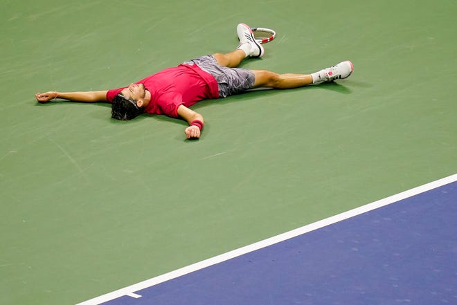 Dominic Thiem, of Austria, reacts after defeating Alexander Zverev, of Germany, in the men's singles final of the US Open championships Sunday in New York.