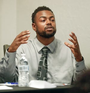 Jarvis Washington, president of Black Lives Matter Restoration Polk, speaks during a town hall on race relations in Lakeland at Cannon Funeral Home on June 8.