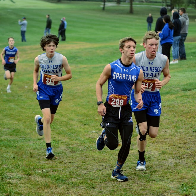 Colo-NESCO's Chevy Dunlap (right) and Ben Rouse run with Collins-Maxwell's Jacob Pierick during the Tigerhawk Invitational in Colfax Sept. 10. Dunlap placed 13th and Rouse 15th to help the Royals finish a close third behind Collins-Maxwell and Colfax-Mingo.