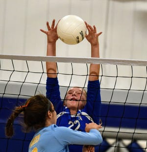 Colo-NESCO middle blocker Sophia Pizali goes up for a block during the Royals' match with Lynnville-Sully Sept. 8 in Colo.