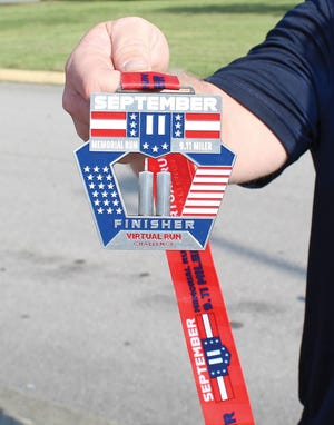 Oak Ridge firefighters ran a 9/11 Remembrance Run on Thursday morning in memory of those who died in the 2001 attacks. The run began at 8:46 a.m., the same time the first Twin Tower was hit on Sept. 1, 2001. It was 3.43 miles to honor the 343 firefighters who died on that day, according to city information. They then extended the run's route to include the 9/11 memorial at Oak Ridge High School. Those who completed the initial run received a medal.