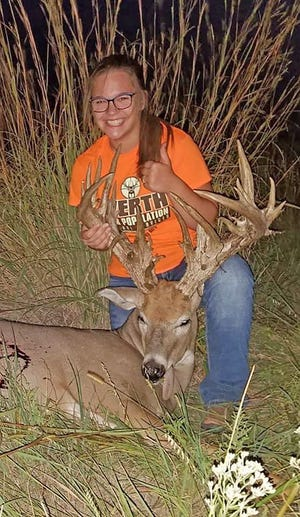 Fourteen-year-old Paslie Werth, of Cimarron, shot this 40-point whitetail buck unofficially measuring 282 6/8 inches while hunting with her father, Kurt, on family-owned property in Kiowa County.