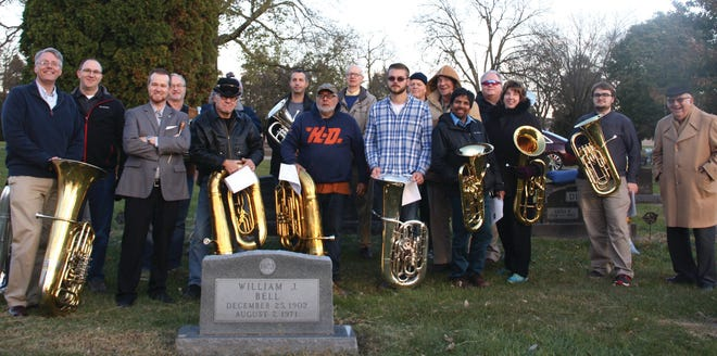 Tuba players gather around William Bell's grave at Violet Hill Cemetery during the 41st William Bell Tuba Day in 2019. The 2020 edition has been canceled.