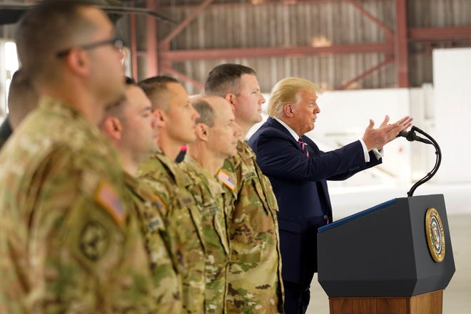 President Donald Trump honors seven members of the California National Guard at Sacramento McClellan Airport on Monday for their heroic rescue of stranded fire victims last week. Standing to the president's right is Chief Warrant Officer Joseph Rosamond of Manteca, who was among four Stockton-based Chinook crew members who were honored.