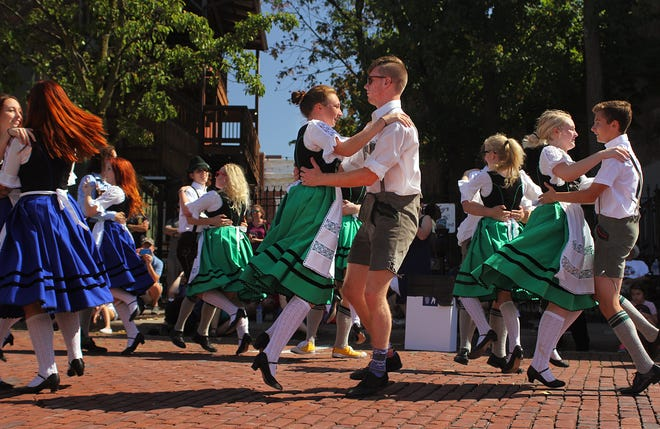 Carlie Freiss and Thomas Leipold dance with the German Family Society Youth Group at the 2017 Oktoberfest in downtown Kent. After missing last year's event due to the COVID-19 pandemic, this year's Oktoberfest in Kent will take place Sept. 25.