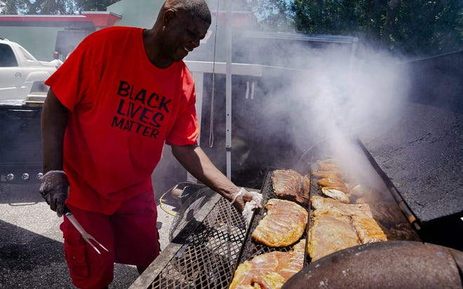Hundreds gather for a Juneteenth celebration along Dr. Martin Luther King Jr. Way in Newtown in June.  Only 12 of Newtown's businesses received a one-time grants worth thousands of dollars from the city. Sarasota awarded 166 grants elsewhere.