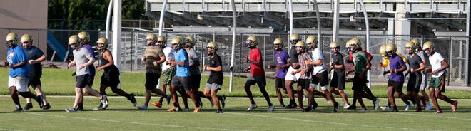The Booker High football team looks to improve on last year's 1-9 record.