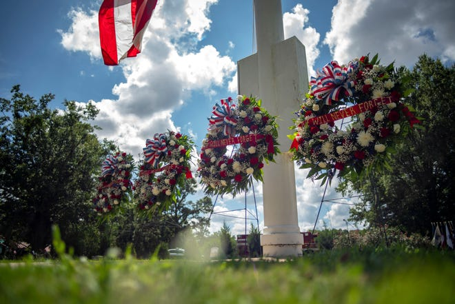 Wreaths representing the heroes of the city of Fayetteville and Fort Bragg honor the fallen during the 18th Airborne Corps 9/11 remembrance ceremony Friday at Fort Bragg. (U.S. Army Photo by Spc. Nathaniel Gayle, 22nd Mobile Public Affairs Detachment)