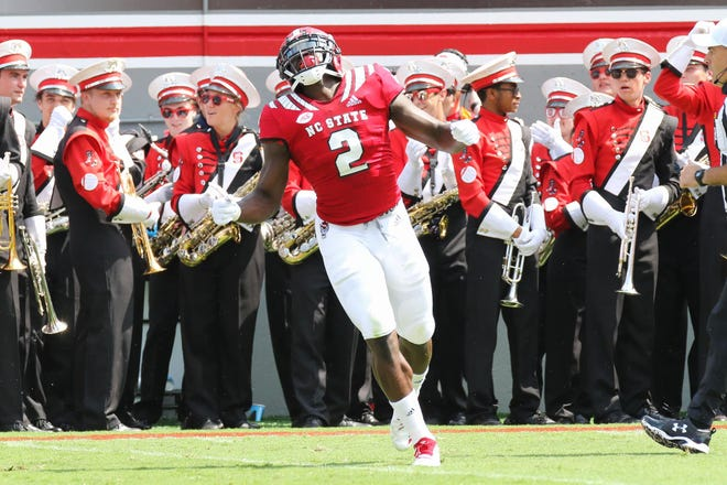 Injury problems have forced N.C. State senior linebacker Louis Acceus to give up the sport.