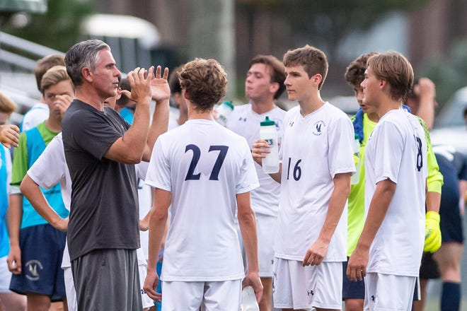 Coach Andrew McCarthy talks to Fayetteville Academy players during a 2018 match.  McCarthy, who has coached the Eagles for 20 years, is part of a soccer dynasty with 17 state championships since 1984. The Eagles will play for another state title Saturday in High Point.