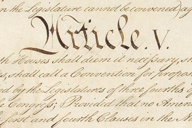 This photo made available by the U.S. National Archives shows Article V of the United States Constitution.