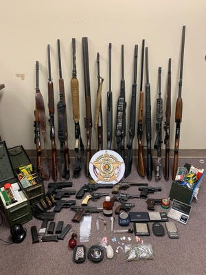 DeKalb County law enforcement agencies seized guns and a variety of drugs during a large-scale drug raid at a home near Mentone.