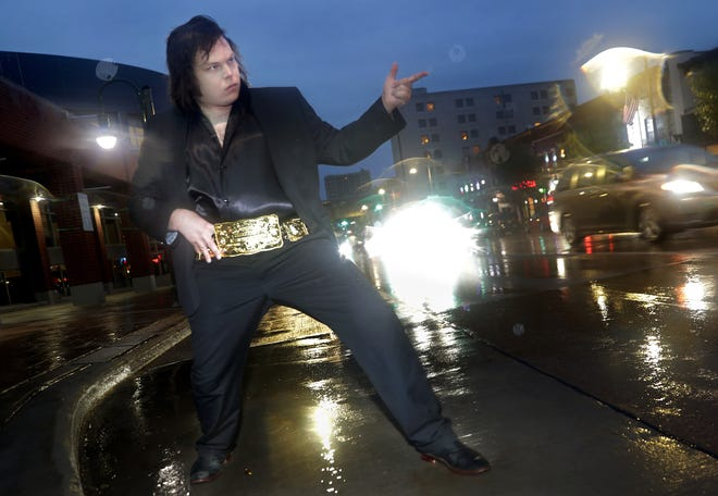 Elvis tribute artist Aaron Smith, Greenville, on Tuesday, September 8, 2020, on College Avenue in Appleton, Wis. Wm. Glasheen USA TODAY NETWORK-Wisconsin