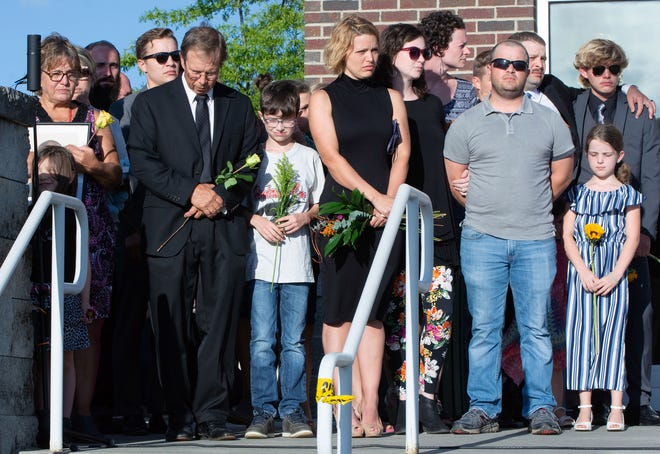 Members of the Hendrix family stood together throughout a 90-minute memorial service held Sunday evening in honor of 35-year-old Henderson County Sheriff's Deputy Ryan Hendrix, who was killed in the line of duty on Thursday.