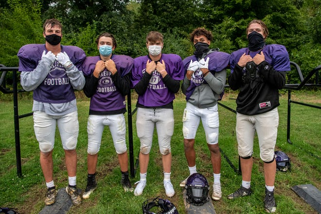 From left, Lakeview varsity football players Joel Metzger, Sawyer Shotwell, Aidan Rankin, Jaden Simonson and Mason Belmore pose for a picture after practice on Thursday, Sept. 10, 2020 at Lakeview High School in Battle Creek, Mich.