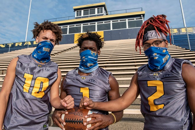 Battle Creek Central's Jalen Jackson (10), Felix Shorter (1) and Omarion Davis (2) pose for a picture on Friday, Sept. 11, 2020 at Battle Creek Central High School.