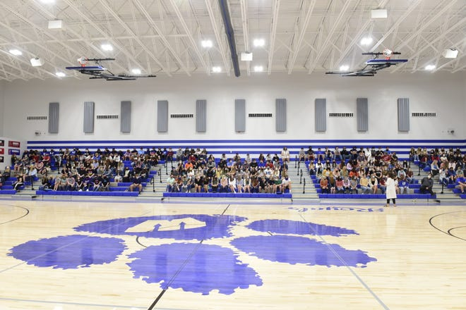 Julie Miller, principal of Wynford High School, welcomes students to their new building Monday morning.