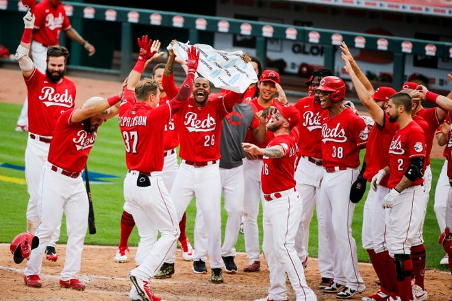 Cincinnati Reds pinch hitter Tyler Stephenson celebrates with his teammates after hitting a two-run home run to beat the Pittsburgh Pirates 3-1during the day game on Monday, Sept. 14, 2020, at Great American Ball Park in Cincinnati.