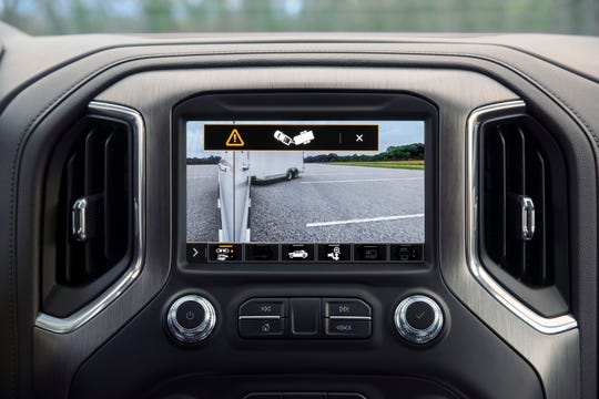The 2021 GMC Sierra will have new technology called the jack-knife alert on it. It tracks the position of thetrailer in relation to the pickup. If the front of the trailer approaches the rear of the pickup, an alert is displayed that there couldbe ajack-knife situation.