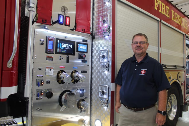 Jason Conklin, Lindsey Volunteer Fire Department's deputy fire chief, stands next to the department's new truck Monday. The 2020 Freightliner fire truck is the department's first four-door cab and features a SAM water pump control system, the first of its kind in Ohio.