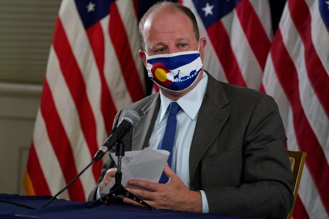 Colorado Governor Jared Polis makes a point during a news conference about the state's efforts against the the new coronavirus Thursday, Sept. 3, 2020, in Denver.