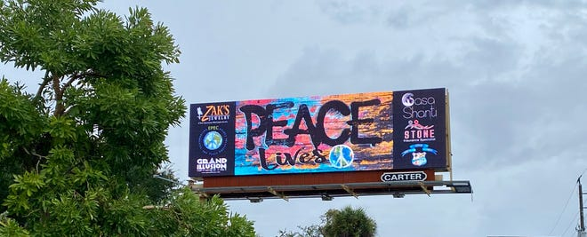 The new Peace Day billboard on U.S. 41 in south Fort Myers near Gladiolus Drive.