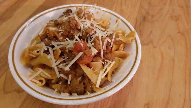 Bolognese isn't difficult to make, but needs more time adding browned ground beef to a pasta sauce.