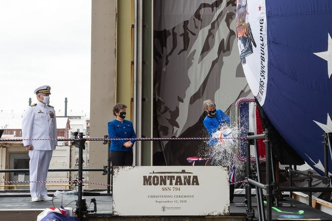 Former Secretary of the Interior Sally Jewell on Sept. 12 christens the Virginia-class submarine Montana (SSN 794). From left, the ship's commanding officer, Capt. Michael Delaney, and Newport News Shipbuilding President Jennifer Boykin look on.