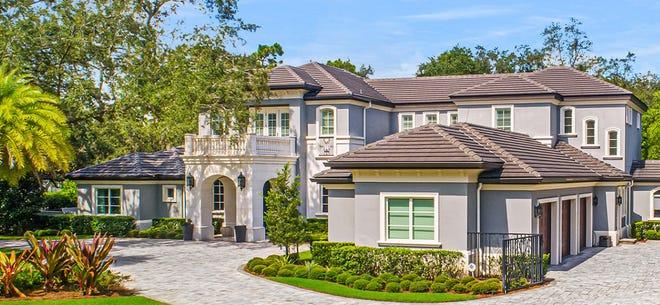 Former Notre Dame football coach Lou Holtz has put his Orlando home for sale.