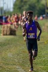 Izaiah Steury leads the pack at a meet earlier this month at Indiana Wesleyan.