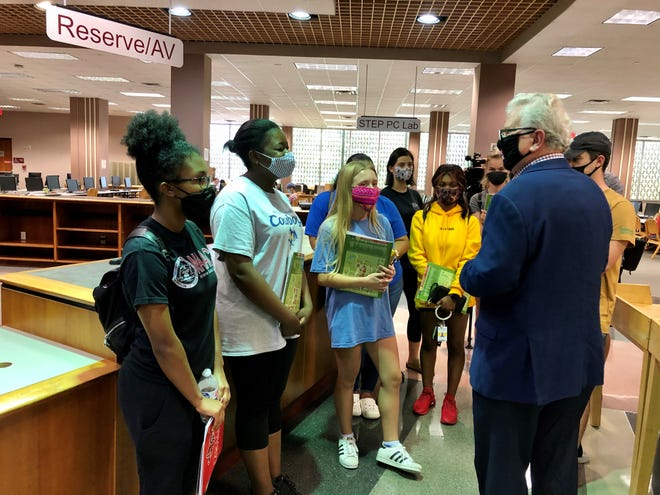UL Lafayette President Joe Savoie greets McNeese State students while on a tour of the Edith Garland Dupré Library, part of orientation Monday, Sept. 14, 2020.