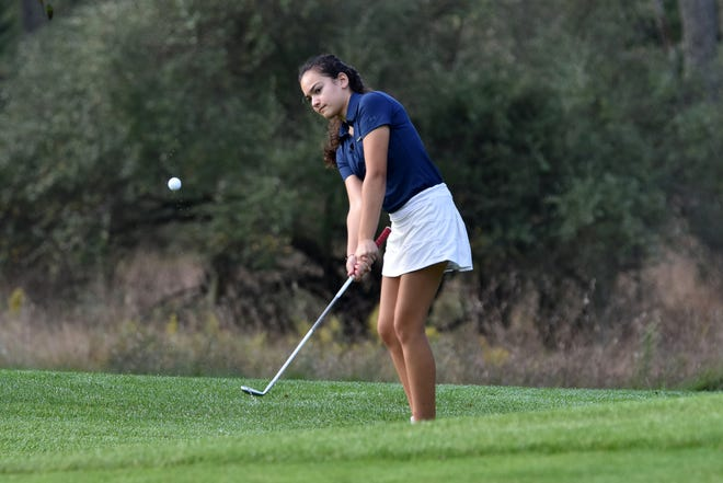 Violet Sinishtaj of Hartland shot 76 to tie for first in the Mustang Girls Golf Tournament at Huron Meadows Metropark.
