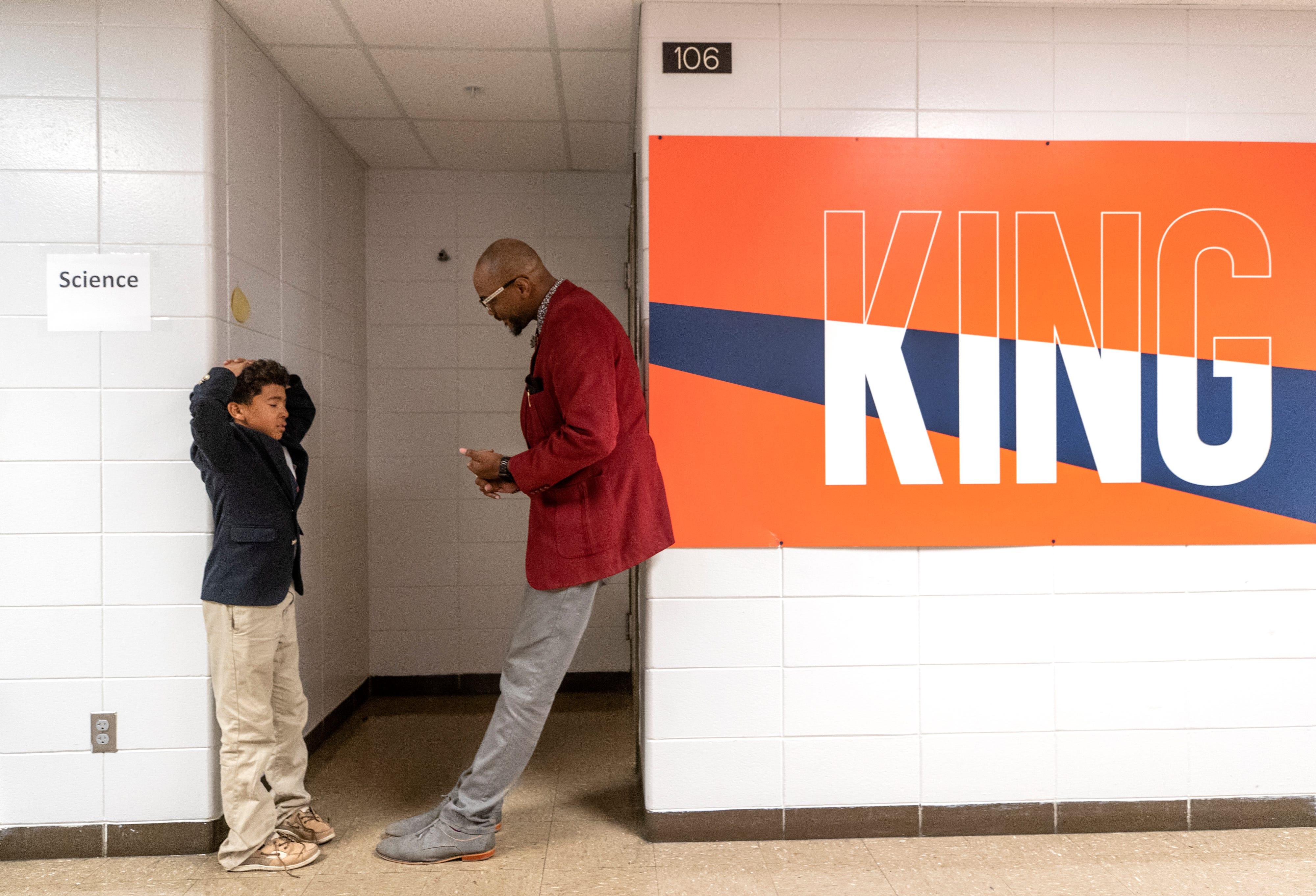 W.E.B. DuBois Academy ECE teacher Ellis Tarver talks with sixth grade student Jaden Parker in the hallway after an incident in the classroom. Oct. 17, 2019.
