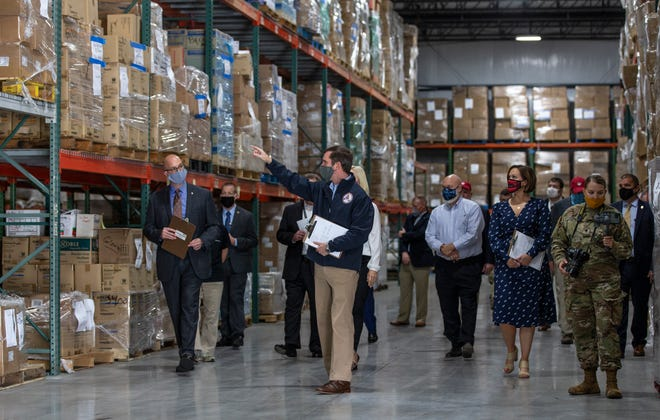 Gov. Andy Beshear toured a Kentucky warehouse where state emergency services has stockpiled personal protective equipment in the event of a coronavirus surge. Sept. 14, 2020