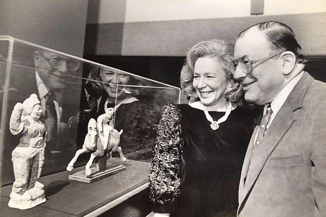 Rudi and Honey Scheidt view the opening of an art exhibit in 1984.