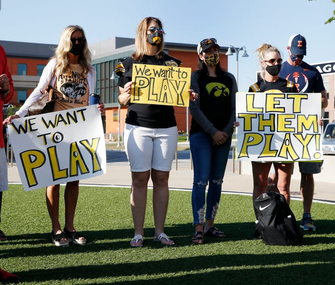 Families of Iowa football players protest outside Big Ten headquarters in August, pushing for the league to reverse its decision and go ahead with football this fall.