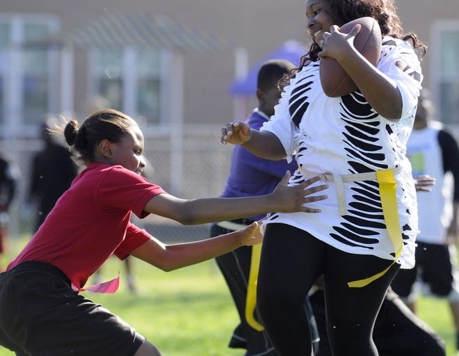 People enjoy the first One Community, One Family, ONE Montgomery Flag Football Tournament at the Goode Street Community Center on Saturday, Feb. 26, 2011, in Montgomery, Ala.