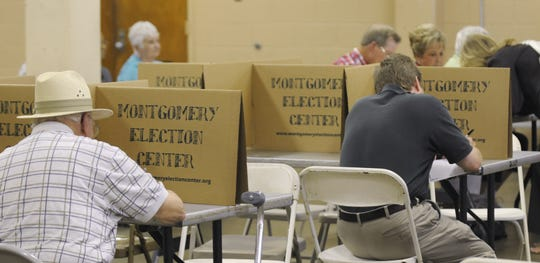 People arrive to vote at Goodwyn Community Center on Tuesday, Aug. 23, 2011, in Montgomery, Ala.