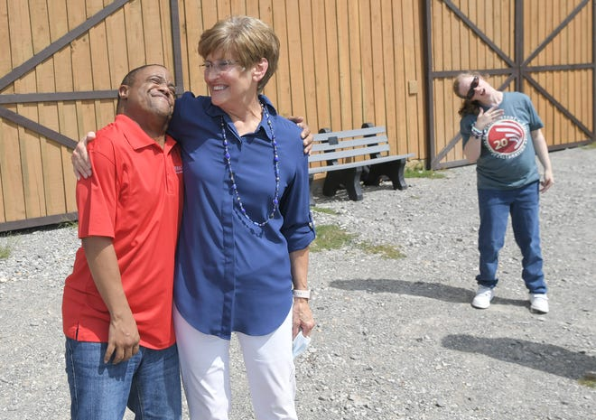 BrightStone CEO and founder Brenda Hauck gives Reggie Gift, 43, a hug while visiting BrightStone's future $25 million campus in Franklin on Friday, Sept. 11, 2020.  BrightStone will be building a residential community for adults with special needs.