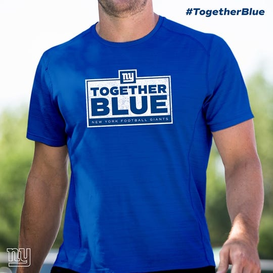 """NY Giants have distributed t-shirts as part of their """"Together Blue"""" campaign to every member of the organization."""