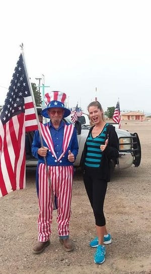 Krystal Cayada poses with Uncle Sam during the Rolling Rally Parade on Friday in Deming, NM.