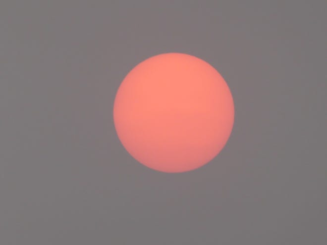 The sun turns orangish-red when viewed through the hazy skies over Las Cruces the morning of Saturday, Sept. 12, 2020.